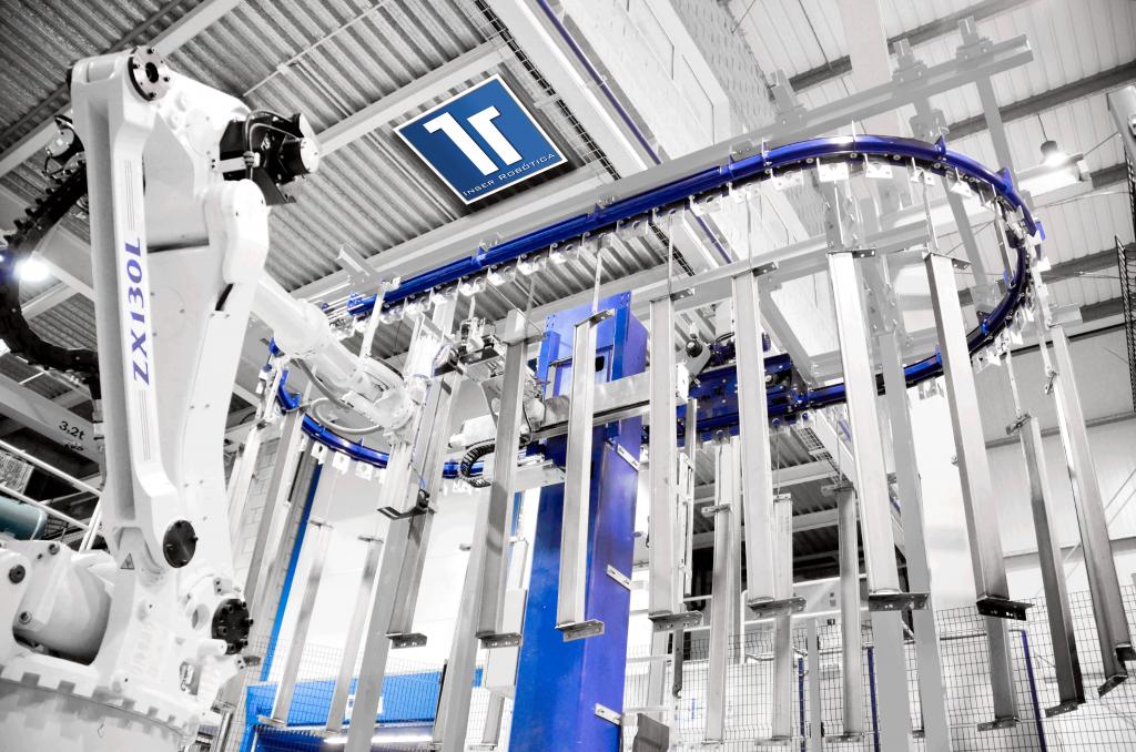 Cuelgue automático sobre línea de pintura con robot